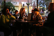 BRENDAN FITTERER  |  VISIT FLORIDA<br /> From left, Maren Jalladeau, Annabel Serio, Julie Miller and  Bob Pecha listen to Mark Serio and Friends perform at Mattison's City Grille downtown Sarasota, 1 North Lemon Ave Sarasota, FL 34236.