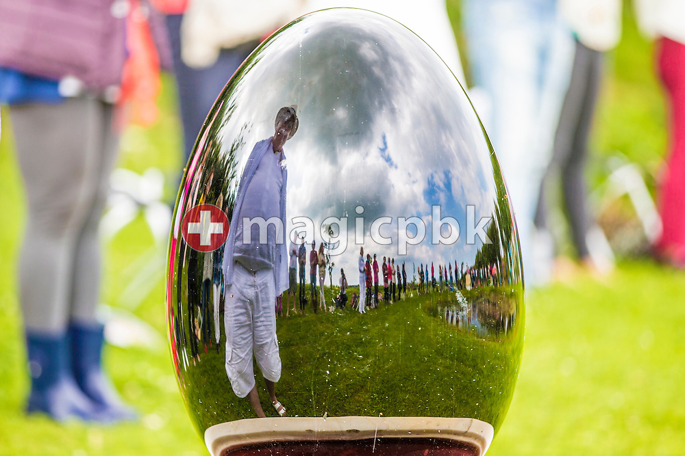 Mike Booth is reflected in a crystal egg during the seminar 7 Levels of Letting Go at the Heart Chakra on the Chakra Path at Shire Farm in Hagworthingham, Lincolnshire, Great Britain, Friday, June 20, 2014. (Photo by Patrick B. Kraemer / MAGICPBK)