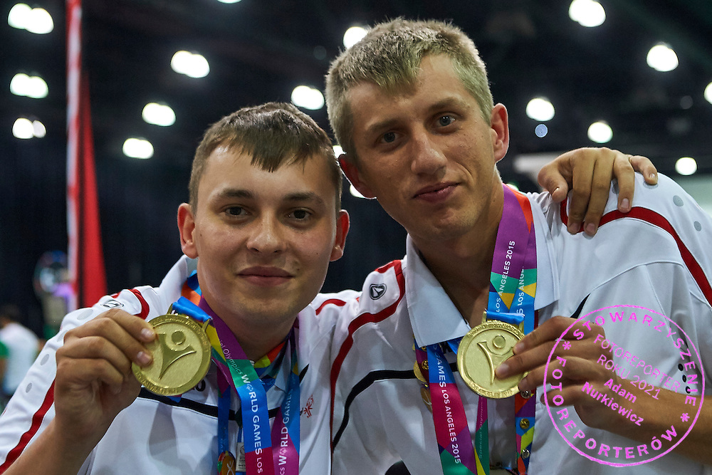 (L) SO Poland athlete Patryk Jaszcz and (R) SO Poland athlete Mateusz Kaczmarek pose with gold medals after medal ceremony after bowling competition during fifth day of the Special Olympics World Games Los Angeles 2015 on July 29, 2015 at Los Angeles Convention Centre in Los Angeles, USA.<br /> <br /> USA, Los Angeles, July 29, 2015<br /> <br /> Picture also available in RAW (NEF) or TIFF format on special request.<br /> <br /> For editorial use only. Any commercial or promotional use requires permission.<br /> <br /> Adam Nurkiewicz declares that he has no rights to the image of people at the photographs of his authorship.<br /> <br /> Mandatory credit:<br /> Photo by &copy; Adam Nurkiewicz / Mediasport