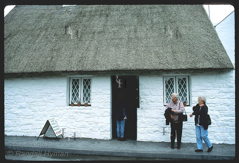 Tourists visit Quiet Man Heritage Cottage museum, a replica of film's White O'Mornin home; Cong Ireland