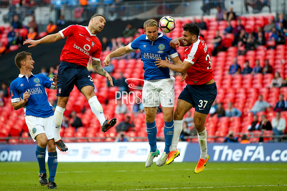 Macclesfield Town Defender John McCombe (6) heads goal wards during the FA Trophy match between Macclesfield Town and York City at Wembley Stadium, London, England on 21 May 2017. Photo by Simon Davies.