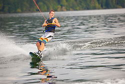 United States, Washington, Kirkland, male teen wakeboarding on Lake Washington.  MR