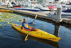 United States, Washington, Kirkland (near Seattle), Man kayaking in marina