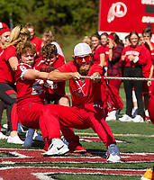 "The Senior class backs up Tyler Richter in the ""tug of war"" during Laconia High School's Pep Rally for Homecoming Friday afternoon.  (Karen Bobotas/for the Laconia Daily Sun)"