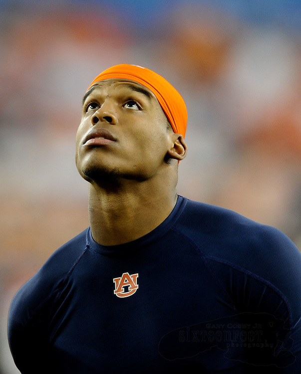 Daily Photo by Gary Cosby Jr.   ..Auburn quarterback Cam Newton looks up at the roof in The University of Phoenix Stadium before the BCS National Championship Game in Glendale, AZ Monday.  Newton was doing a walk through with the other Auburn quarterbacks and offensive coordinator Gus Malzahn.