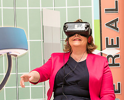 Cabinet Secretary for Culture, Tourism and External Affairs, Fiona Hyslop visits one of the highlights of the annual Edinburgh International Science Festival, Play On at the National Museum of Scotland. Play On is a family-friendly, interactive exhibition which is divided into four zones (Game Theory, Make Some Noise, Toy Box and Picture This) and explores how technology influences our leisure time.<br />  <br /> Ms Hyslop met with the Science Festival's Directors, Simon Gage and Amanda Tyndall, as well as the artists and designers behind the Play On.<br /> <br /> Pictured: Fiona Hyslop using a Virtual Reality headset <br /> <br /> Pictured: Fiona Hyslop using a Virtual Reality headset