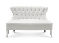 Small white leather sofa loveseat isolated on white background with clipping path