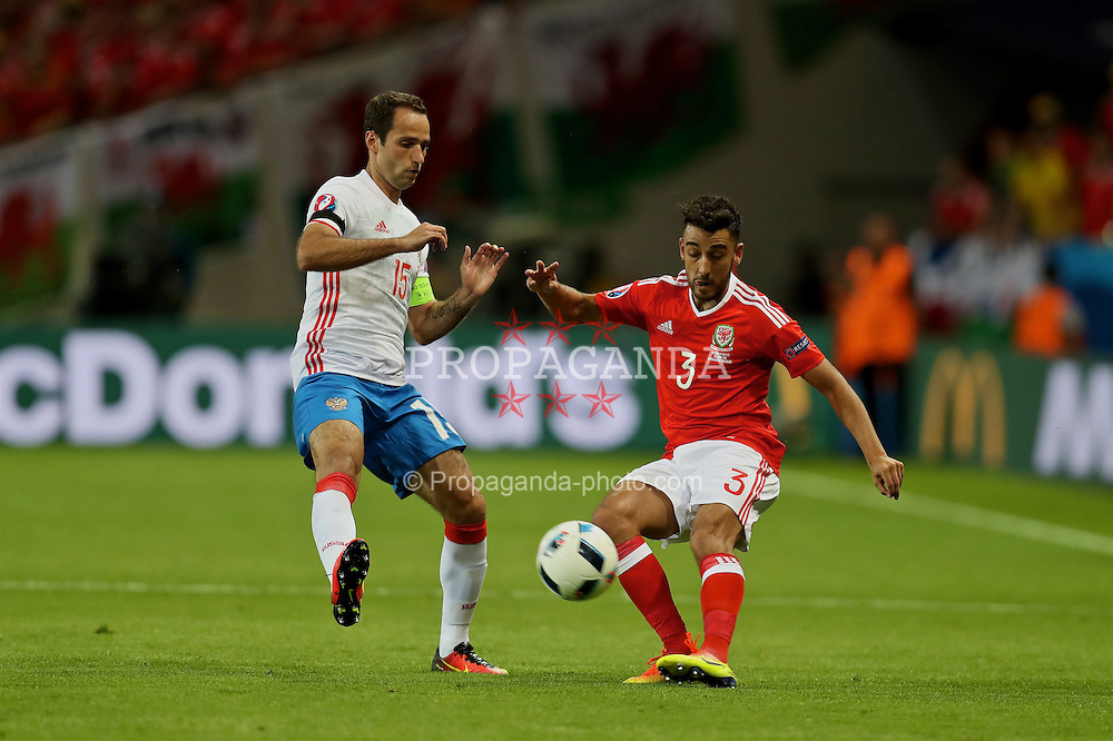 TOULOUSE, FRANCE - Monday, June 20, 2016: Wales' Neil Taylor in action against Russia's Roman Shirokov during the final Group B UEFA Euro 2016 Championship match at Stadium de Toulouse. (Pic by David Rawcliffe/Propaganda)