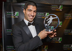 LONDON, ENGLAND - Monday, December 16, 2013: Liverpool's Luis Suarez receives the Player of the Year Award at the Football Supporters Federation Awards Night at the Emirates Stadium. (Pic by Steve Welsh/William Hill/Propaganda).