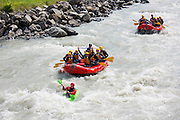 Tourists white water rafting towards Interlaken in the Bernese Oberland, Switzerland