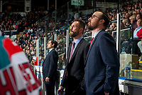 KELOWNA, CANADA - APRIL 25: Kelowna Rockets' head coach Jason Smith and Assistant coach Kris Mallette stand on the bench and watch the replay on the jumbo iron against the Seattle Thunderbirds on April 25, 2017 at Prospera Place in Kelowna, British Columbia, Canada.  (Photo by Marissa Baecker/Shoot the Breeze)  *** Local Caption ***