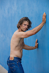 portrait of a sexy shirtless man with long brown hair