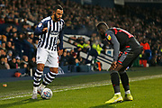 Matt Phillips takes on Bruno Martins Indi during the EFL Sky Bet Championship match between West Bromwich Albion and Stoke City at The Hawthorns, West Bromwich, England on 20 January 2020.