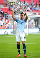 Manchester City's John Stones celebrates with the Community Shield after winning the Community Shield match at Wembley Stadium, London.