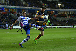 Chris Gunter of Reading clears the ball under pressure from Daryl Murphy of Newcastle United - Mandatory by-line: Jason Brown/JMP - 07/03/2017 - FOOTBALL - Madejski Stadium - Reading, England - Reading v Newcastle United - Sky Bet Championship
