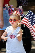 Children wave flags during an Independence Day parade  despite a dramatic rise in COVID-19, coronavirus cases in Charleston County July 4, 2020 in Mount Pleasant, South Carolina. South Carolina is currently number three nationwide in number of infected per population.