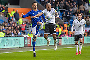 André Ayew of Swansea City controls the ball under pressure from Robert Glatzel of Cardiff City during the EFL Sky Bet Championship match between Cardiff City and Swansea City at the Cardiff City Stadium, Cardiff, Wales on 12 January 2020.