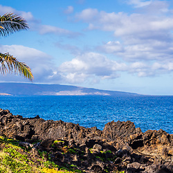 Maui Hawaii panoramic photo at Wailea Makena with a palm tree along Wailea Beach Path. In the background is an outrigger canoe and Kaho'olawe Island along the Pacific Ocean. Panorama photo ratio is 1:3. Copyright ⓒ 2019 Paul Velgos with All Rights Reserved.
