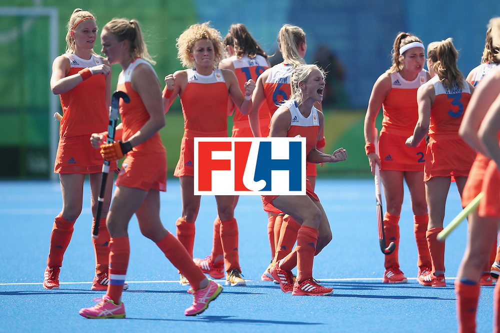 RIO DE JANEIRO, BRAZIL - AUGUST 17:  The Netherlands players celebrate during the penalty shootout during the womens semifinal match between the Netherlands and Germany on Day 12 of the Rio 2016 Olympic Games at the Olympic Hockey Centre on August 17, 2016 in Rio de Janeiro, Brazil.  (Photo by Mark Kolbe/Getty Images)