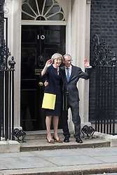 Downing Street, London, July 13th 2016. New British Prime Minister Theresa May arrives at her official residence 10 Downing Street following HM The Queen's approval and permission to form a new government following the resignation of David Cameron. Flanked by her husband Philip she addressed the media.