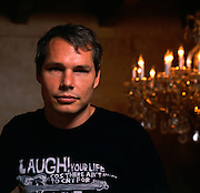 """Los Angeles, California: artist Shepard Fairey in the stairwell of his studio, """"Studio One,"""" on Sunset Blvd. around the corner from Dodger Stadium in the Echo Park district of Los Angeles, 7/14/08."""