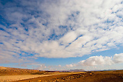 The Ramon Crater, Negev, Israel. clouds formations above the crater, Ramon Crater is one of the most spectacular geological features of Israel's Negev Desert, and is the world's largest karst erosion cirque. It is located at the peak of Mount Negev, some 85 kilometers south of the city of Beer-Sheva. The Ramon Crater is 40 kilometers long and 2 to 10 kilometers wide, shaped like an elongated heart.