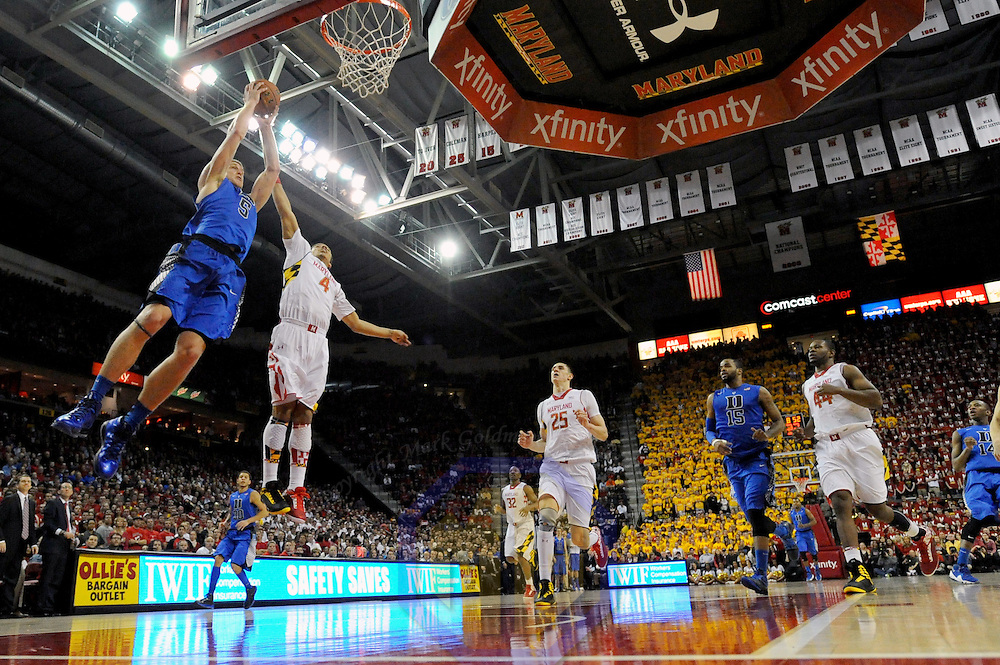 16 February 2013:   Duke Blue Devils forward Mason Plumlee (5) in action against Maryland Terrapins guard Seth Allen (4) at the Comcast Center in College Park, MD. where the Maryland Terrapins upset the second ranked Duke Blue Devils, 83-81.