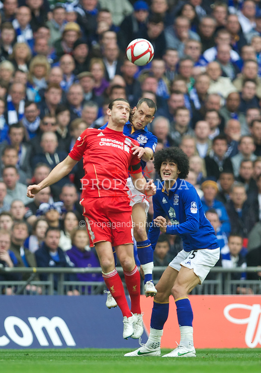 LONDON, ENGLAND - Saturday, April 14, 2012: Liverpool's Andy Carroll and Everton's Leon Osman during the FA Cup Semi-Final match at Wembley. (Pic by David Rawcliffe/Propaganda)