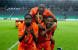 Players of Netherlands Queensy Menig of Netherlands, Jeroen Lumu of Netherlands, Riechedly Bazoer of Netherlands and Djavan Anderson of Netherlands celebrate after winning the UEFA European Under-17 Championship Final match between Germany and Netherlands on May 16, 2012 in SRC Stozice, Ljubljana, Slovenia. Netherlands defeated Germany after penalty shots and became European Under-17 Champion 2012. (Photo by Vid Ponikvar / Sportida.com)