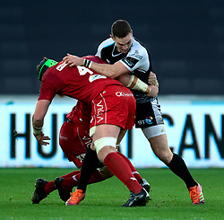 George North of Ospreys under pressure from Jake Ball of Scarlets<br /> <br /> Photographer Simon King/Replay Images<br /> <br /> Guinness PRO14 Round 11 - Ospreys v Scarlets - Saturday 22nd December 2018 - Liberty Stadium - Swansea<br /> <br /> World Copyright © Replay Images . All rights reserved. info@replayimages.co.uk - http://replayimages.co.uk