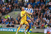 Brighton & Hove Albion central defender Lewis Dunk & Preston North End striker Callum Robinson (37) compete for  high ball during the EFL Sky Bet Championship match between Brighton and Hove Albion and Preston North End at the American Express Community Stadium, Brighton and Hove, England on 15 October 2016. Photo by Bennett Dean.