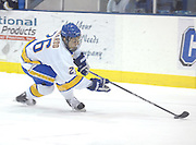 Lake Superior State's Domenic Monardo chases down the puck during the Lakers Saturday night game against Notre Dame in Sault Ste. Marie.