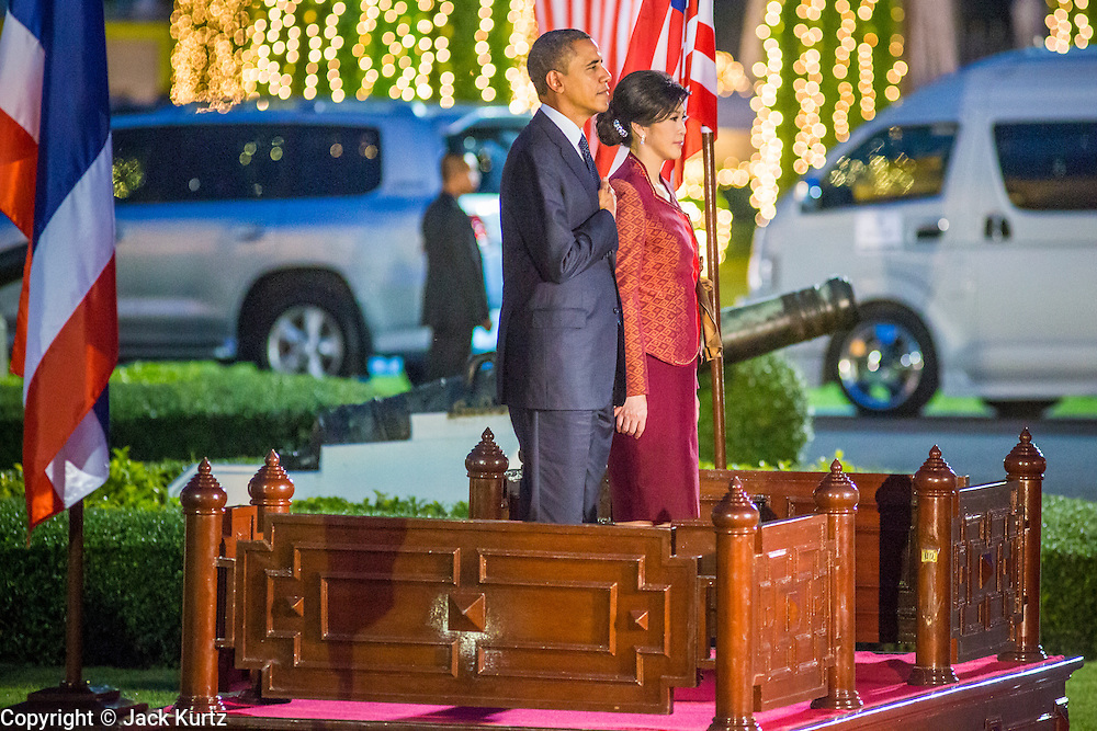 18 NOVEMBER 2012 - BANGKOK, THAILAND:  US President Barack Obama and Thai Prime Minister Yingluck Shinawatra during the National Anthems of their countries. US President Barack Obama arrives for the start of his tour of Southeast Asia on November 18, 2012 in Bangkok, Thailand. Barack Obama will become the first US President to visit Myanmar during the four-day tour of Southeast Asia that will also include visits to Thailand and Cambodia.   PHOTO BY JACK KURTZ