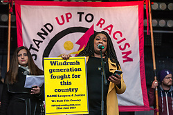 London, UK. 16th March, 2019. A speaker from the BAME Lawyers 4 Justice addresses thousands of people on the March Against Racism demonstration on UN Anti-Racism Day against a background of increasing far-right activism around the world and a terror attack yesterday on two mosques in New Zealand by a far-right extremist which left 49 people dead and another 48 injured.