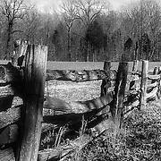 Wooden split rail fence in winter