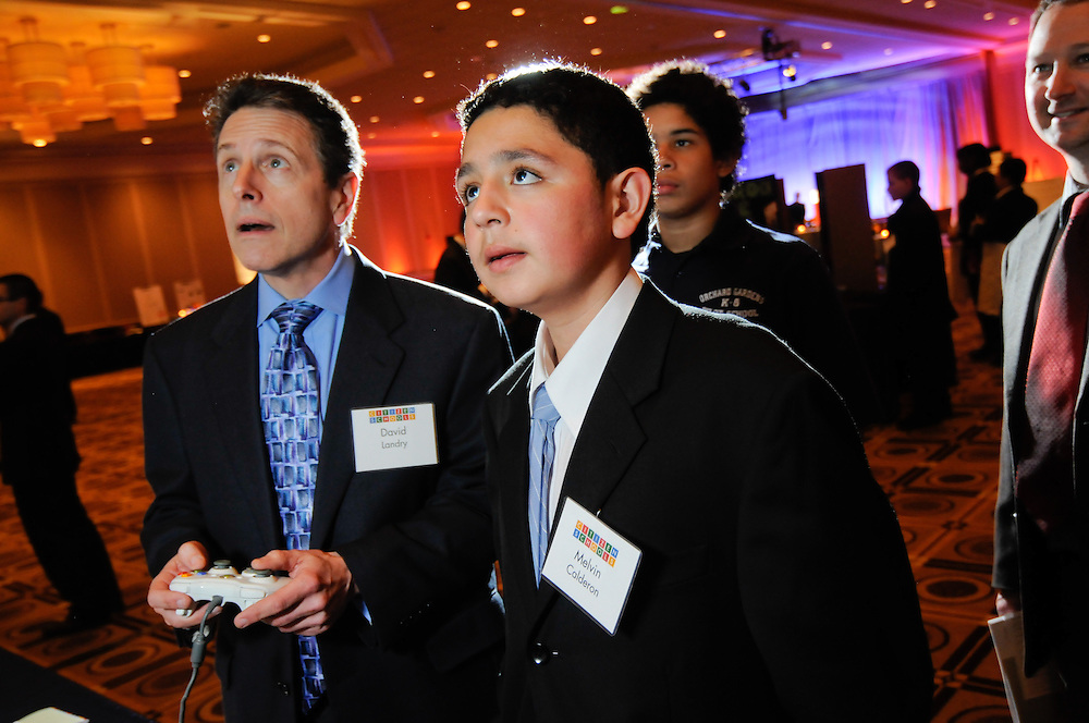 A Citizen Schools student shows off the video game he created in his ten week long apprenticeship at the WOW Affair held at the Westion Copley Place in Boston's Back Bay.