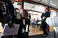 """27 MAR 2009, BITTERFELD/GERMANY:<br /> Franz Muentefering, SPD Parteivorsitzender, hoert dem musiklischen Vortrag von Bitterfelder Bergleuten zu, waehrend einer Rundfahrt auf einem See mit einem Gespraech zum Thema """"Soziales Engagement"""", Ausflugsschiff MS Vineta<br /> IMAGE: 20090327-01-026<br /> KEYWORDS: Franz Müntefering"""