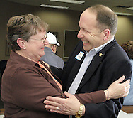 """Bev Looker (left) gets a hug from retired Fairborn Police Chief Ron Carbaugh at a reunion of Fairborn fire fighters at the Fire Administration offices, Friday, April 11, 2008.  Looker's father Lester Davis and Carbaugh's father Joe Carbaugh were firefighters, and Looker's mother was """"like a grandmother to the firemen, who sometimes would spend all day fixing chicken, then a fire truck would come over and take the food back to the firemen."""