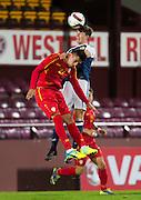 Scotland's Ryan Christie outjumps FYR Macedonia's Daniel Avramovski during Scotland Under-21 v FYR Macedonia,  UEFA Under 21 championship qualifier  at Tynecastle, Edinburgh. Photo: David Young<br /> <br />  - © David Young - www.davidyoungphoto.co.uk - email: davidyoungphoto@gmail.com