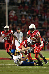 26 September 2009: Chris Garrett intercepts a pass and moves towards the Redbird Goal as Glen Fox, the intended receiver falls to the turf. South Dakota State Jackrabitts jump past the Illinois State Redbirds 38 - 17 at Hancock Stadium on campus of Illinois State University in Normal Illinois