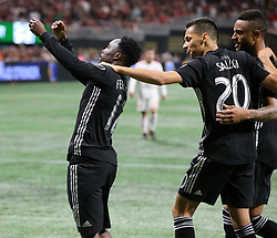 May 9, 2018 - Atlanta, GA, USA - Sporting Kansas City forward Gerso Fernandes, left, celebrates scoring a goal for a 2-0 lead against Atlanta United with Daniel Salloi, who scored the team's first goal, during the second half on Wednesday, May 9, 2018, in Atlanta. Sporting Kansas City won, 2-0. (Credit Image: © Curtis Compton/TNS via ZUMA Wire)