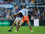 Greg Minikin (R) of Castleford Tigers tackles Ash Handley (L) of Leeds Rhinos during the Betfred Super League match at the Dacia Magic Weekend, St. James's Park, Newcastle<br /> Picture by Stephen Gaunt/Focus Images Ltd +447904 833202<br /> 19/05/2018