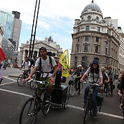The swoop teams Brown and White cuts through Bank, passing the Bank of England on their way to swoop Climate Camp 2009.