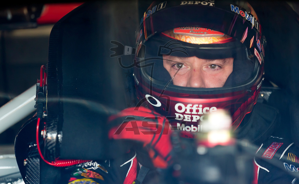 CONCORD, NC - MAY 26, 2012:  Tony Stewart (14) straps in for a practice session for the Coca-Cola 600 at the Charlotte Motor Speedway in Concord, NC.