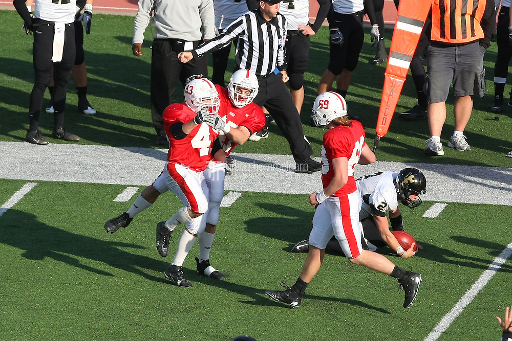 Nick Zweber (43) with Jake King (47) and Connor Gril (69). Credit: Brace Hemmelgarn-Saint John's University