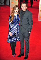 © Licensed to London News Pictures. 12/02/2012. London, England. Bonnie Wright and Jamie Campbell Bower arrive for the Orange British Academy Film Awards at The Royal Opera House on February 12, 2012 in London, England. Photo credit : ALAN ROXBOROUGH/LNP