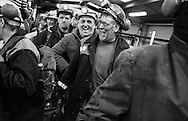 MINERS COMING OFF THE TROLLEY TRAIN AFTER THEIR TEN HOURS SHIFT UNDERGROUND AL LONGANNET COLLIERY, CULROSS. SCOTLAND, APRIL, 2001...