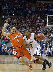 Virginia Tech Hokies guard Jamon Gordon (22) dribbles around Illinois Fighting Illini guard Trent Mecham (1).  The #5 seed Virginia Tech Hokies defeated the #12 seed Illinois Illini 54-52 in the first round of the Men's NCAA Tournament in Columbus, OH on March 16, 2007.