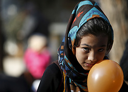 A migrant child holds a balloon in Victoria Square in central Athens, Greece, January 27, 2016. REUTERS/Darrin Zammit Lupi MALTA OUT. NO COMMERCIAL OR EDITORIAL SALES IN MALTA - RTX24AST