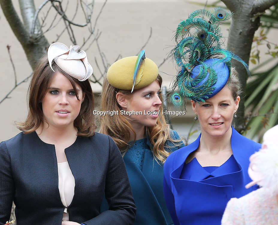 Princess's Eugenie and Beatrice and Sophie, Countess of Wessex leave the Easter Day service at St.George's Chapel, Windsor Castle, Sunday, 31st March 2013.  Photo by: Stephen Lock / i-Images